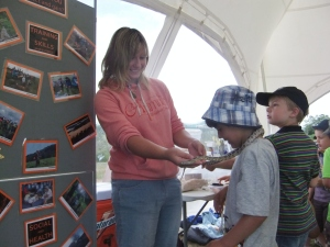 Heart of Exmoor's project assistant, Aggz Waywell, introducing children to 'Alan' the corn snake.