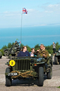 A family taking a ride in one of the military vehicles at the North Hill Big Adventure Day 2013- photo by Aggz Waywell