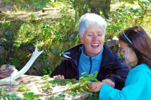Volunteer Anne Rivett showing a young girl some wildlife curiosities from Exmoor- photo by Aggz Waywell 2013