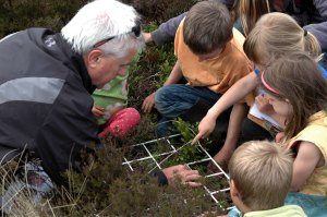 Dave Weatherly, Curriculum Advisor,  with local children exploring Moorland Classroom sites.