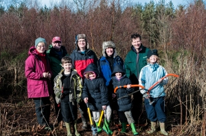 David Rolls, Education and Outreach Officer for the Heart of Exmoor, with volunteers Brian and Caroline Seward and a family group.